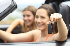 Tourists showing a rental car keys stock images
