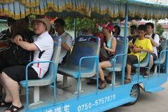 Tourists in the shuttle bus in SHANGCHUAN ISLAND JIANGMEN CITY CHINA Royalty Free Stock Photos