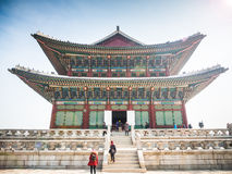 Tourists at the side of Gyeongbokgung Palace. Stock Photos