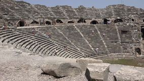 Tourists. SIDE, TURKEY - JUNE 22, 2014: Tourists on the ruins of the Greek Amphitheatre stock video