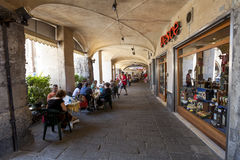 Tourists in sidewalk cafes in Genoa, Italy Royalty Free Stock Photos
