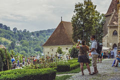 Tourists in Sighisoara citadel, Romania Royalty Free Stock Image