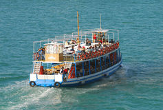 Tourists on sightseeing boat Stock Image