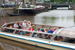 Tourists in sightseeing boat Royalty Free Stock Photos