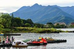 Tourists with sightseeing boats. KAWAGUCHIKO, JAPAN - OCTOBER 8, 2016: Tourists with sightseeing boat at Kawaguchiko lake, Japan Stock Photography