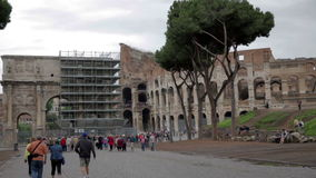 Tourists sightseeing The Colosseum in Rome, Italy stock footage