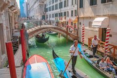 Tourists sightseeing in gondola in Venice canal