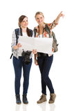 Tourists sightseeing map. Happy two female tourists sightseeing with map Stock Photos