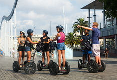 Tourists sightseeing on Segway tour of Barcelona Royalty Free Stock Image