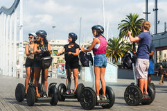 Tourists sightseeing on a Segway tour of Barcelona Stock Photos