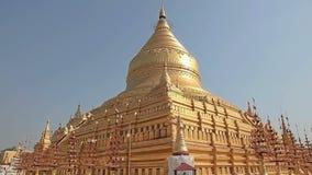 Tourists sightseeing The Shwezigon Pagoda stock video footage