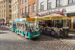 Tourists on sightseeing tour Riga. Tourists on sightseeing tour with street train in Old town of Riga, Latvia. Riga's historical centre is a UNESCO World Stock Image