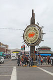 Tourists and sign for Fishermans Wharf in San Francisco Stock Photography