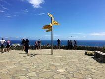 Tourists and signpost at Cape Reinga, Northland, New Zealand Stock Photo