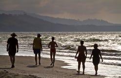 Tourists' silhouettes enjoying the beach in Same. Tourists' silhouettes enjoying the beach at sunset in Same, Ecuador royalty free stock photo