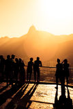 Tourists silhouettes on a Pao do Asucar. Viewpoint with the Rio panorama at the background at the sunset time Stock Photo