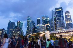 Tourists at the Singapore Merlion Park and Night Cityscape photo. Of Central Business District, Singapore, April 14 2018 Royalty Free Stock Photos