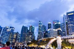 Tourists at the Singapore Merlion Park and Night Cityscape photo. Of Central Business District, Singapore, April 14 2018 Royalty Free Stock Images