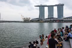 Tourists at the Singapore Merlion Park overlooking Marina Bay Sa. Nds, Singapore, April 14 2018 Royalty Free Stock Images