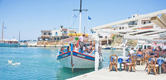 Tourists in Sissi harbor, Crete. stock photography