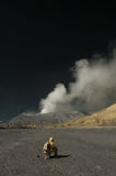 Tourists sit down in front of Bromo mountain stock photos