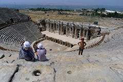 Tourists sit in the spectacular Roman Theatre at Hierapolis near Pamukkale in Turkey. Royalty Free Stock Image