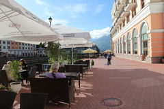 Tourists sitting in a cafe. Rosa Khutor Royalty Free Stock Image