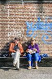 Tourists eat their lunch in the autumn sun. Tourists, sitting on the longest bank in Europe, eat their lunch in the autumn sun. The longest bank is in Royalty Free Stock Photos