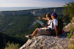 Tourists sitting on mountain Royalty Free Stock Photography