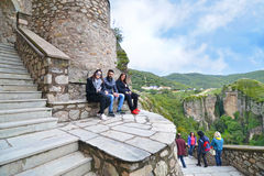 Tourists sitting at the old monasteries of Meteora Greece Stock Photos