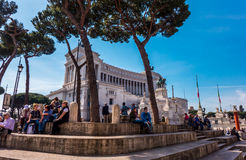 Tourists sitting on Piazza Venezia in Rome Stock Photography