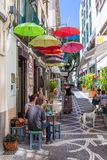 Tourists sitting at the terrace of a small restarant in Funchal, Madeira Island Stock Image