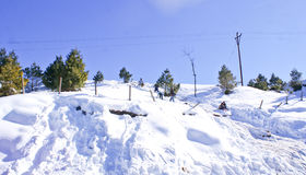Tourists on the slopes of Patnitop. Tourists enjoying on the snow covered slopes of Patnitop in winters Stock Photos