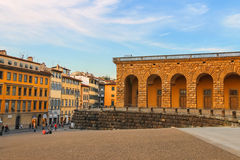 Tourists on a sloping square before the Palace Pitti in evening Stock Images