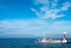 Tourists in small boat looking for dolphins in Lovina, Bali Royalty Free Stock Photos