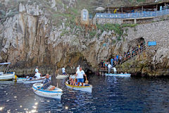 Tourists in small boats waiting to enter the Blue Grotto on Capr Stock Photo