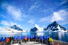 Stunning Lemaire Channel, Antarctica, tourists watching entry in channel filled with ice between mountains, Antarctic Peninsula