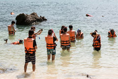 Tourists are snorkeling with life jackets at the Stock Image