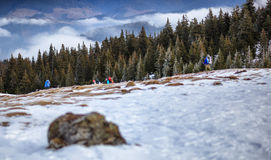 Tourists in the snowy mountains Royalty Free Stock Photos