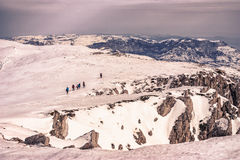 Tourists in the snowy mountains Royalty Free Stock Image