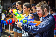 Tourists at Songkran Festival in Bangkok, Thailand. Caucasian tourists shooting water guns at Songkran festival, the traditional Thai New Year, on Khao San Road royalty free stock photography