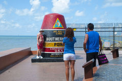Tourists at the Southernmost point, Key West Royalty Free Stock Photos