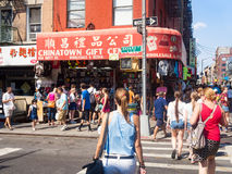 Tourists and souvenirs shop at Chinatown in New York City. NEW YORK,USA - AUGUST 15,2015 : Tourists and souvenirs shop at Chinatown in New York City royalty free stock photo