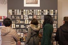 Tourists in a souvenirs shop in Rome. Tourist looking at postcards in a souvenirs shop in Rome Stock Images