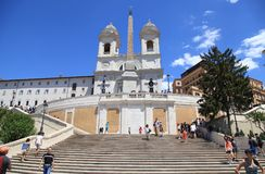 Tourists on the Spanish Steps in Piazza di Spagna, Rome, Italy. ROME, ITALY - JULY 16, 2017: Tourists on the Spanish Steps with The church of Trinita dei Monti Stock Image