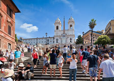 Tourists at the Spanish Steps, Rome, Italy. The Spanish Steps are one of Rome's major tourist attractions with the area becoming very crowded during the summer Royalty Free Stock Photos