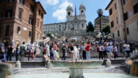 Tourists at the Spanish Steps in Rome Italy. Static wide low angle time lapse shot during a sunny summer day of tourists visiting the Spanish steps, a tourist stock video
