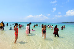 Tourists spend time in sea water in Jolly Buoy Island, Andamans. Unidentified tourists spend time in sea water on February 11, 2012 in Jolly Buoy Island stock photography