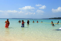 Tourists spend time in sea water in Jolly Buoy Island, Andamans. Unidentified tourists spend time in sea water on February 11, 2012 in Jolly Buoy Island stock image