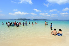 Tourists spend time in sea water in Jolly Buoy Island, Andamans. Unidentified tourists spend time in sea water on February 11, 2012 in Jolly Buoy Island stock photo